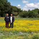 Photo of student interns in meadow they planted with native wildflower seeds.